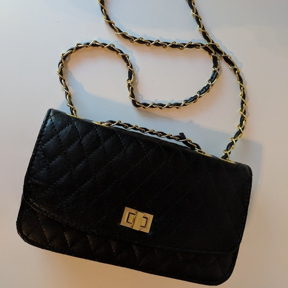 Black quilted purse with gold chain strap